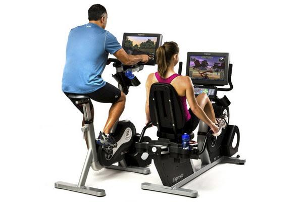 Какой велотренажер выбрать для тренировок дома: советы от производителей и продавцов